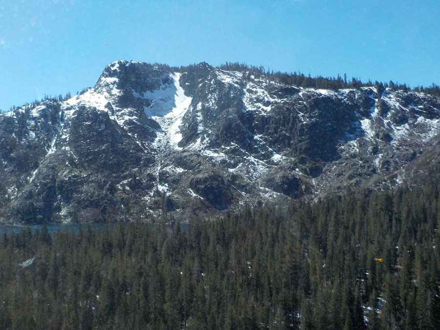 English Mountain rises above the forest, spotted with snow.