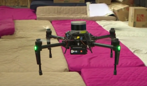 A four-legged drone looks like a big black spider.