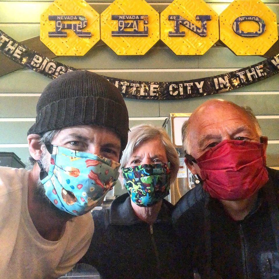Aaron Foster, Wendy Ward, and Ken Ward are all wearing face masks as they look into the camera at Aaron's restaurant, which is called food and drink.