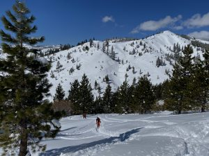 Backcountry skiers climb up Donner Ridge.