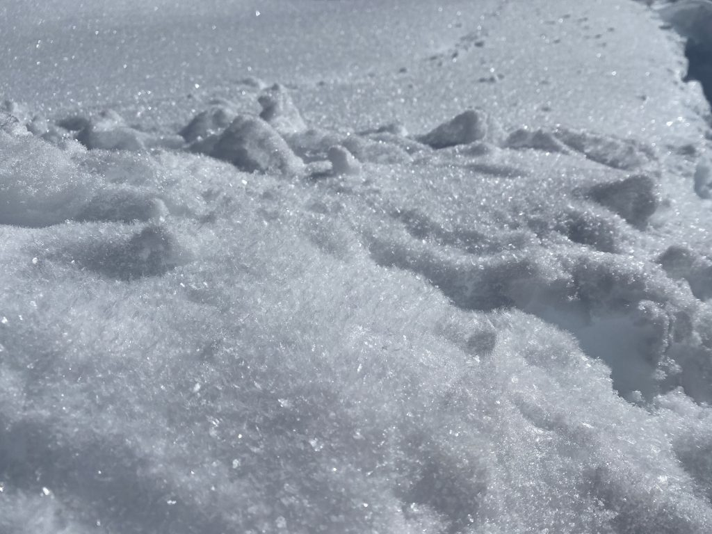 A close-up photo of snow crystals.