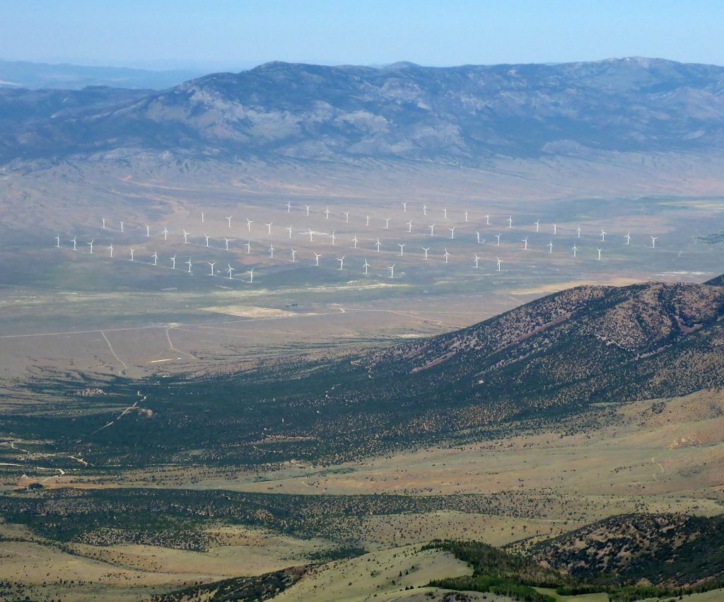 An aerial view from the mountains showing the Spring Valley Wind facility in the valleys beneath.