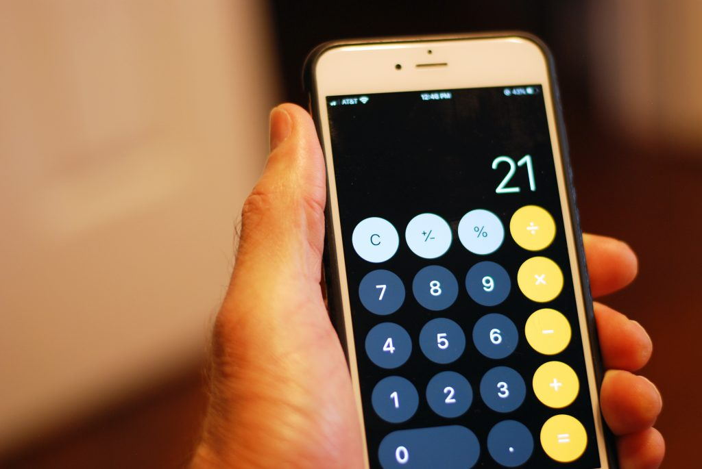 An iPhone displays the calculator app with the number 21 typed in.