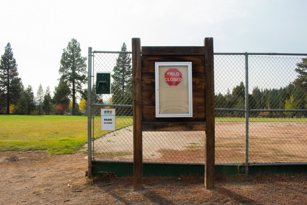 "A ""field closed"" sign in front of the empty field of Glenshire Elementary School"