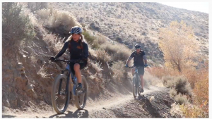Mountain bikers role down a Nevada trail.