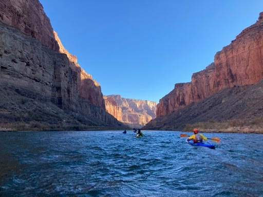 Kayakers paddle the Colorado River through the Grand Canyon.