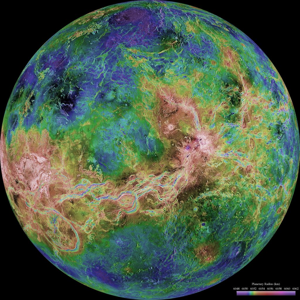 A very colorful view of the planet Venus. Lines of brown and green mix with blue and green splotches to make up the planet.